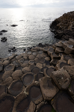 giants: The Giants Causeway is an area of about 40,000 interlocking basalt columns, the result of an ancient volcanic eruption. Stock Photo