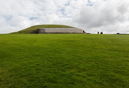 Newgrange is a Stone Age monument in the Boyne Valley, County Meath,  is best known for the illumination of its passage and chamber by the winter solstice sun Stock Photo
