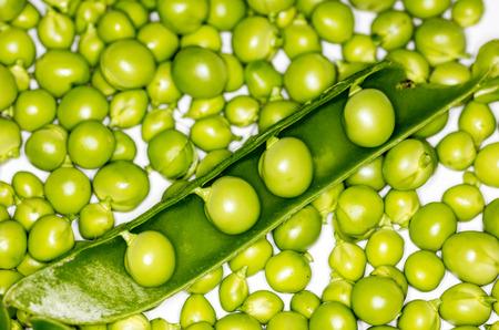 bean family: Fresh green peas closeup on a white backround Stock Photo