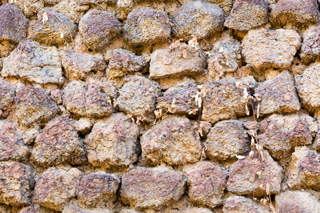 Backround of wall of brick in tuff and stone Stock Photo