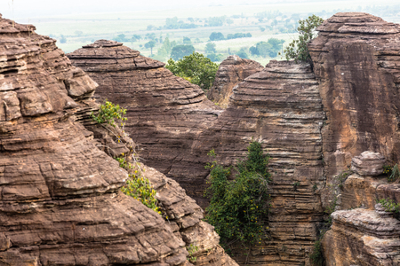 the Domes de Fabedougou  are natural phenomenon of rock sculpted by wind and erosion in Burkina faso look like a stack of pancakes Stock Photo