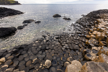 The Giants Causeway is an area of about 40,000 interlocking basalt columns, the result of an ancient volcanic eruption. Stock Photo