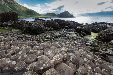 volcanic eruption: The Giants Causeway is an area of about 40,000 interlocking basalt columns, the result of an ancient volcanic eruption. Stock Photo