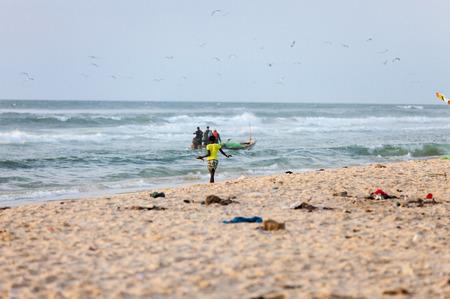pez vela: girl waiting for the fishermen, MBour.Senegal