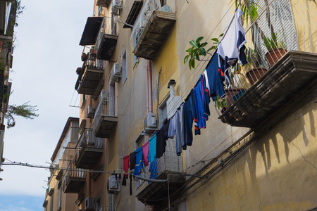 Narrow alley with hanging clothes, Naples, Italy Stock Photo