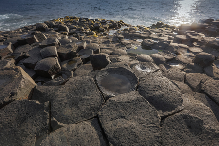 rock formation: The Giants Causeway is an area of about 40,000 interlocking basalt columns, the result of an ancient volcanic eruption. Stock Photo