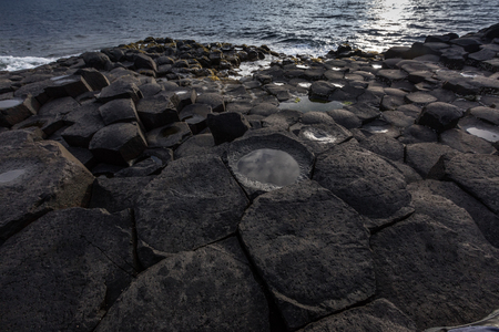 geological formation: The Giants Causeway is an area of about 40,000 interlocking basalt columns, the result of an ancient volcanic eruption. Stock Photo