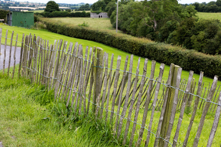 Wooden fence on a green backround in Newgrange, Ireland Stock Photo