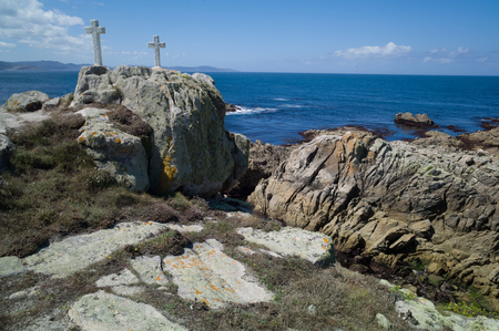 Death Coast with lighthouse and cross of dead fishermen in Galicia