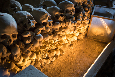 Skull and bones in ancient ossuary, Naples