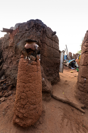 Anthill used like an animist site in caratheristic village in Burkina Faso Stock Photo