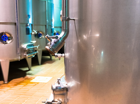 Cellar with an industrial wine production system