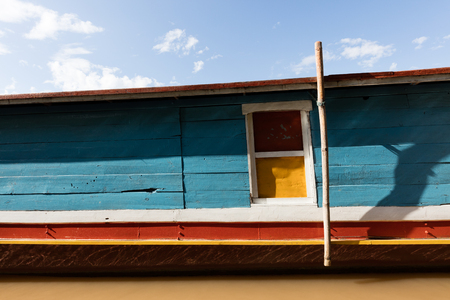 Coloured boat on Mekomg river in  Laos Stock Photo