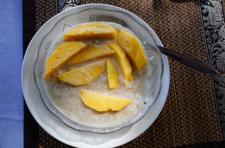 sweet rice and papaya at restaurant in Laos