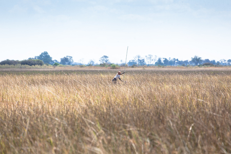woman  on a boat in Okavango Delta,  Botswana Stock Photo