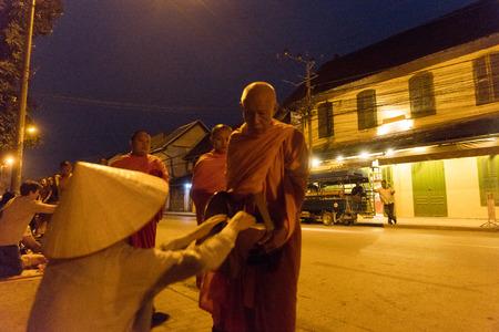 Feeding the monks. The ritual is called Tak Bat, Luang Prabang, Laos. Editorial