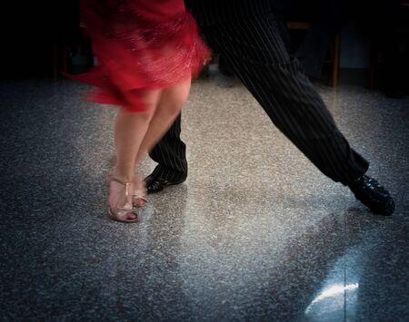 Detail of tango dancers in milonga ballroom