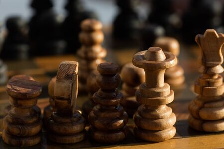 Chess pieces on wooden chessboard backround 스톡 콘텐츠