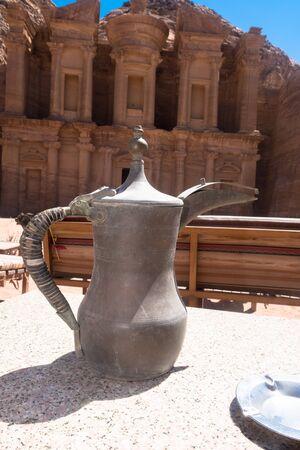 Arabuc coffee pot on backround of Monastery in Petra