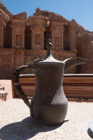 Arabuc coffee pot on backround of Monastery in Petra