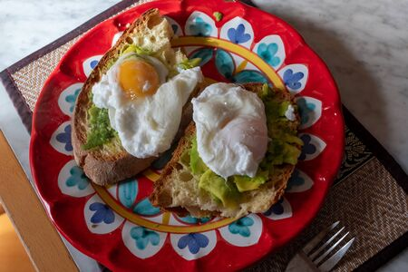 poached eggs with bread and avocado