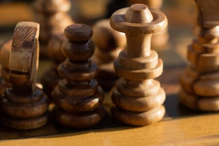 Chess pieces on wooden chessboard backround