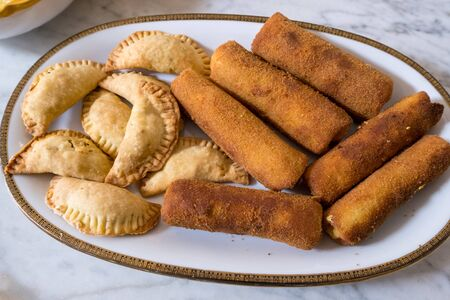 Sri Lankan rolls and samosas homemade  filled with chickemn, curry and tuna