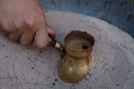Preparation of desert arabic coffee on hot sand