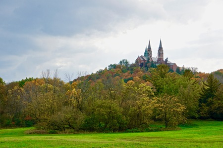 Holy Hill National Shrine of Mary, Help of Christians church on hill on October fall day with leaves changing color