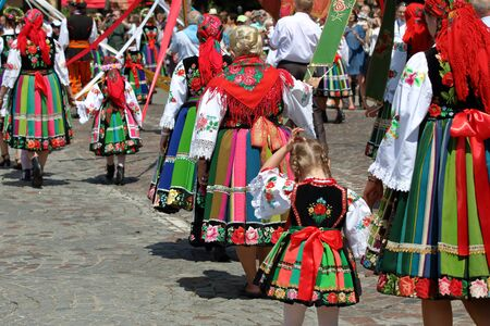 Women, girls, children during annual Corpus Christi procession in Lowicz, Poland, in traditional regional folk costumes