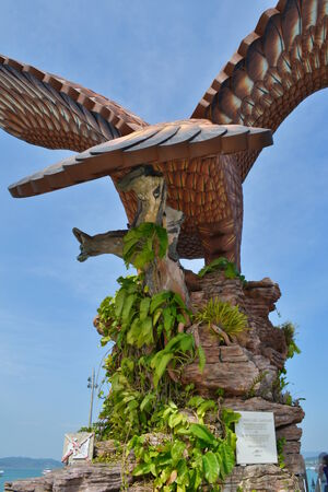lang: A statue of an eagle which is the iconic symbol for the Langkawian people at the Dataran Lang from the back point of view showing it