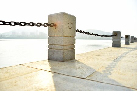 chain fence: chain fence by the bank Stock Photo