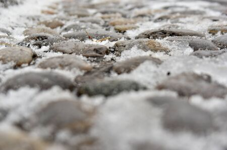 gravel:  snow on gravel pavement Stock Photo