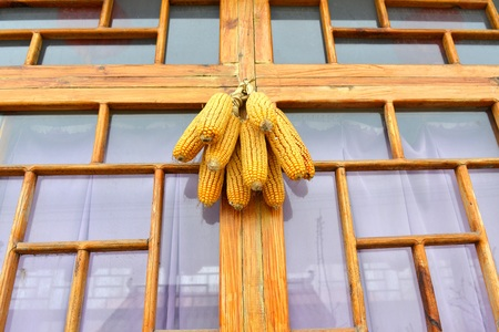 window sill: Old corn hung on the window sill