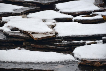 coldness: Snow on the rock Stock Photo