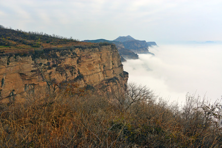 perilous: sea  clouds of the cliff Stock Photo