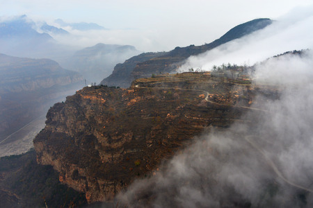 perilous: village with cloud and mountain scenery