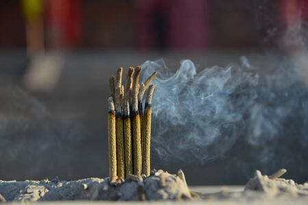 Temples burn incense