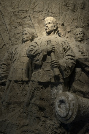 Carved sculpture on rock wall at museum in Shandong, China