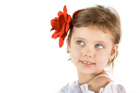 Little girl with red rouses in the hair Stock Photo