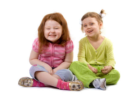 two laughing little girls, isolated on white Stok Fotoğraf