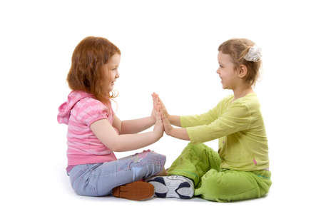 Two little girls play, isolate over white Stock Photo