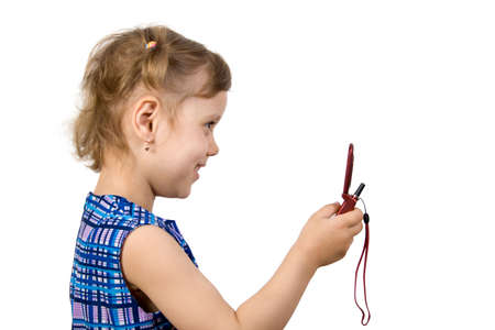 Fun little girl read SMS, isolate on white Stock Photo