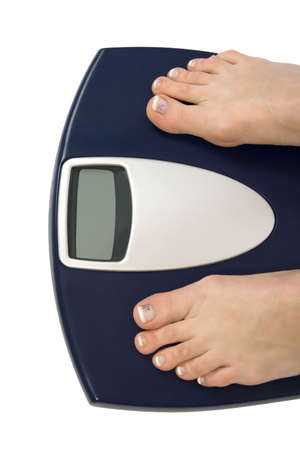 Female feet standing on a bathroom scale Stock Photo - 969442