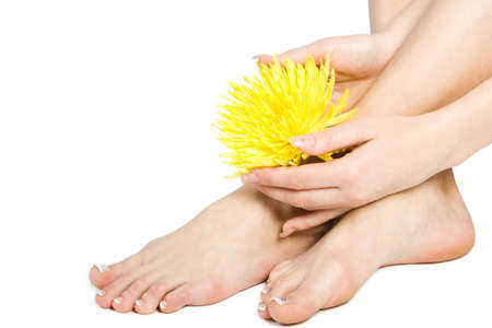 Woman's foot and hand with flowers isolate on white Stock Photo - 969444