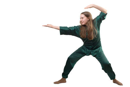 Young girl training martial arts, isolate on white