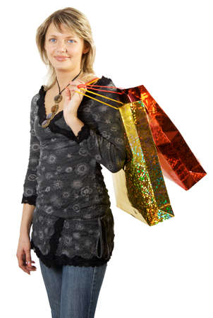 Shopping day. Blonde with blue eyes taking shopping bags. Isolate on white. Stock Photo - 1585137
