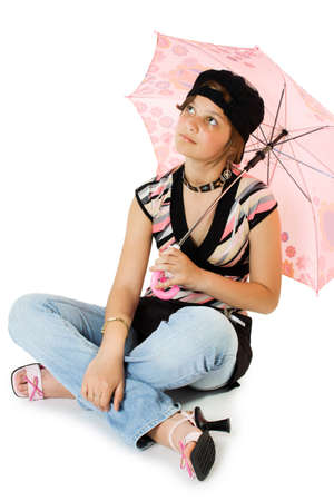 beatitude: Young girl with umbrella sits on floor. Isolate on white. Stock Photo