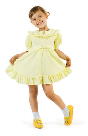Happy girl in yellow dress. Isolate on white background.