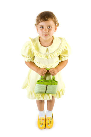youngs: Little smiling girl with green bag. Isolate on white background.